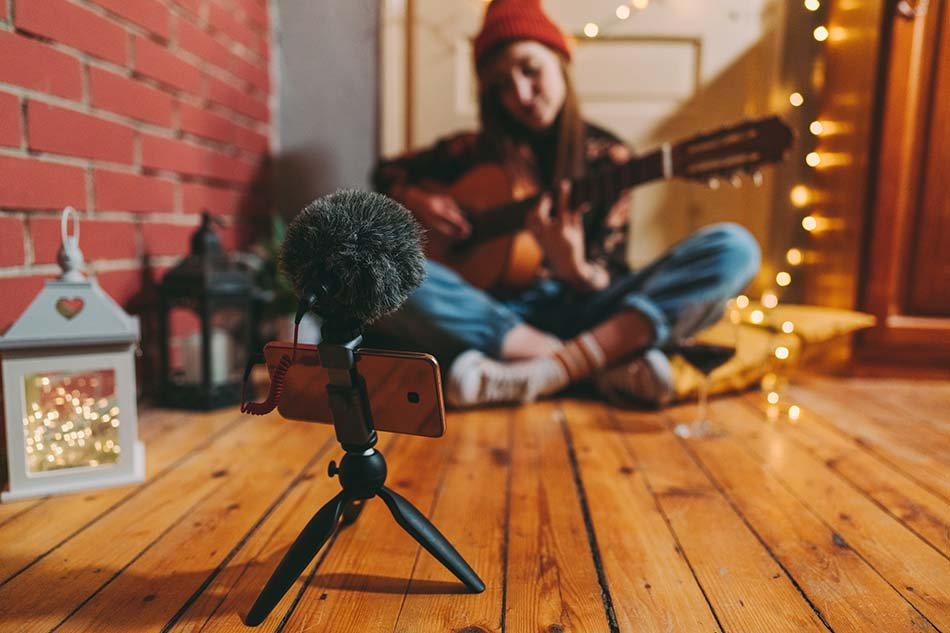 Adding a microphone, tripod, and lights to your smartphone can be cheap and massively upgrade your production value.